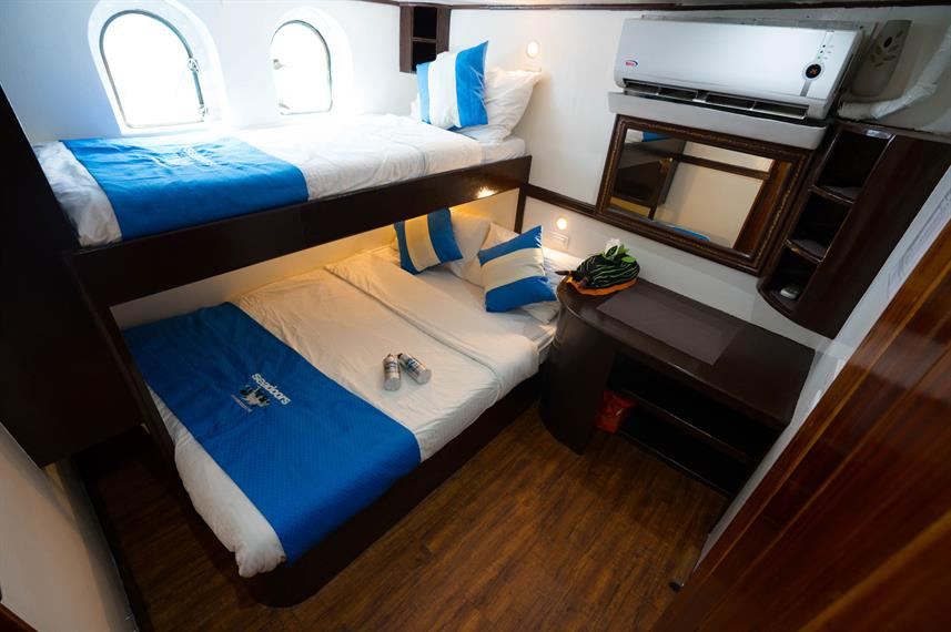 Sleep in comfortable rooms as you cruise through the Visayas on Philippine Seadoors)