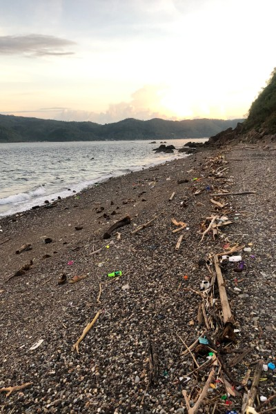 Secret Bay Beach in Anilao littered with trash